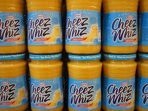 Cheez Whiz Jars in a Supermarket