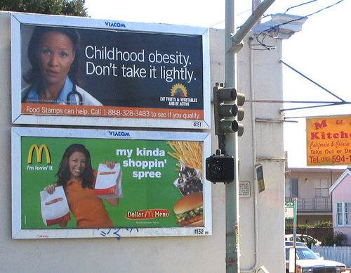 Childhood Obesity Poster Next to McDonald's Promo