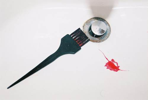 Hair Dye Brush in a Sink