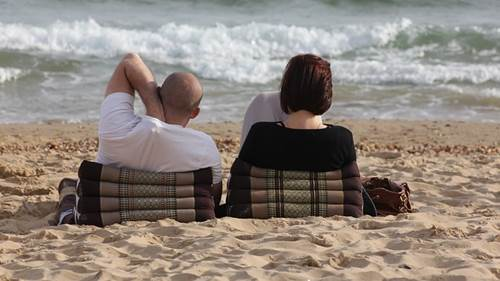 A Couple Relaxing on a Beach
