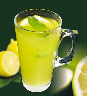 Glass of Lemonade and Cut Lemons