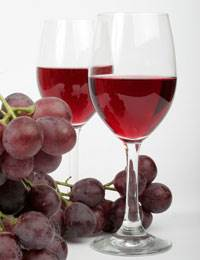Red Grapes and Glasses of Red Wine