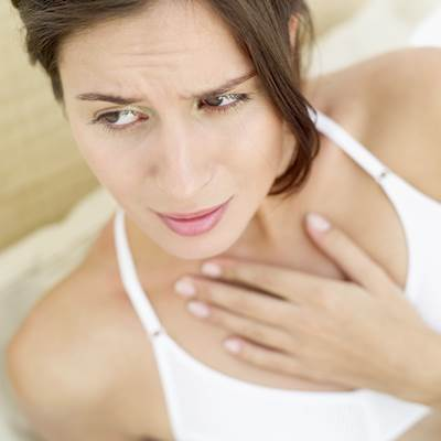 Woman Suffering from Acid Reflux