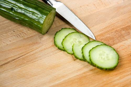 Sliced Cucumber and a Knife