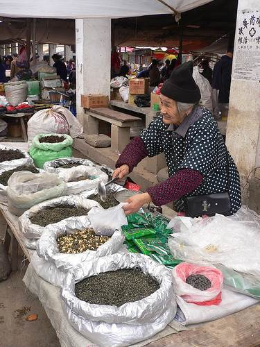 An Old Woman Vendor in China Tea Market