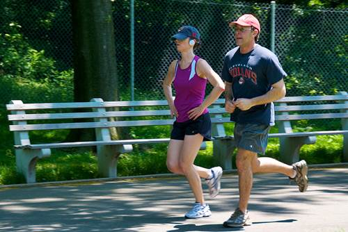A Couple Jogging in a Park