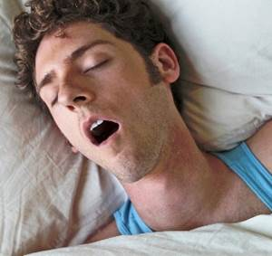 Sleeping Man Snoring with His Mouth Open