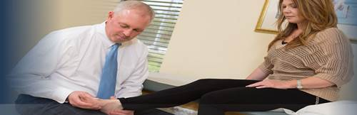 An Orthotist treating a Woman Suffering from Plantar Fasciitis