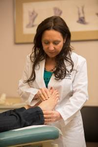 An Orthotist Performing Stretching Exercises on a Plantar Fasciitis Patient 3