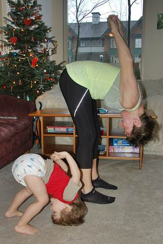 A Stay-At-Home Mom Working Out with her Little Son