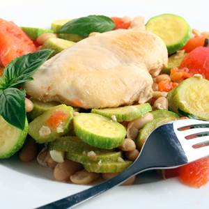 Boiled Chicken and Vegetables Dish Served on a Plate with Fork
