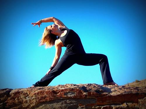 Woman in a Warrior Pose of Yoga