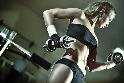 Young Woman Weight Training with Dumbbells