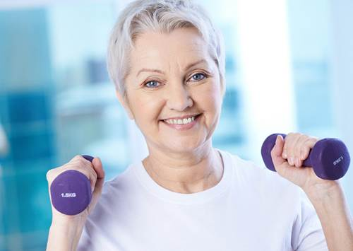 Elderly Woman Lifting Light Dumbbells